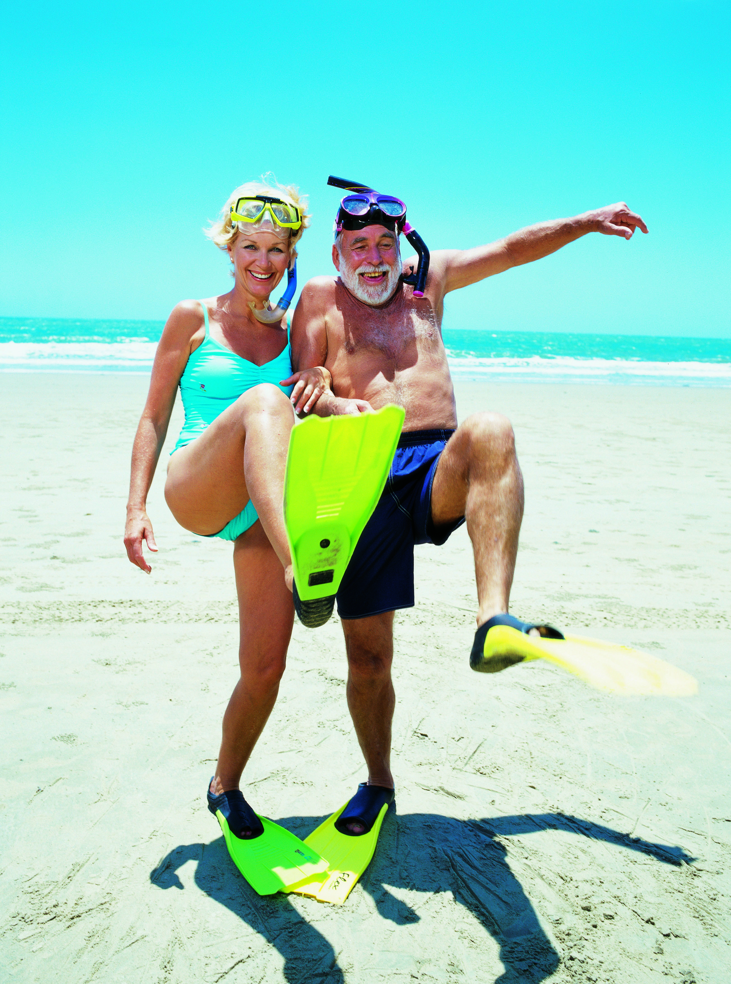 Old couple snorkelling