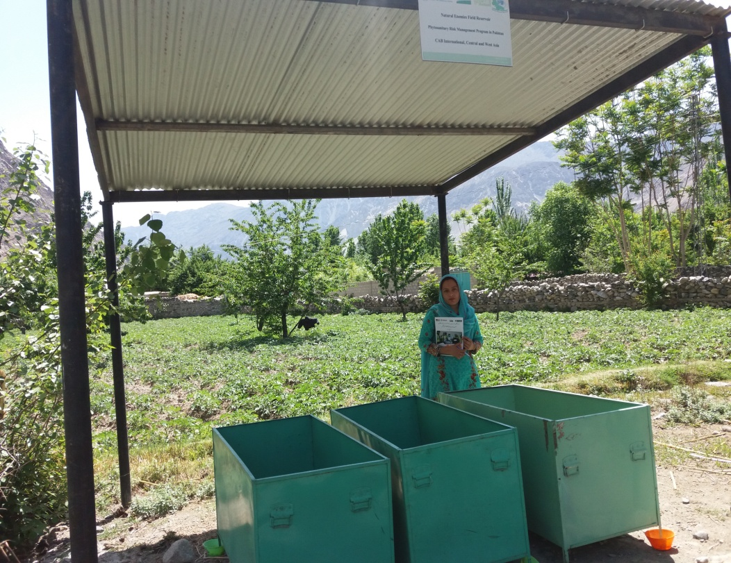Rozina monitoring the mini NEFR at her farm